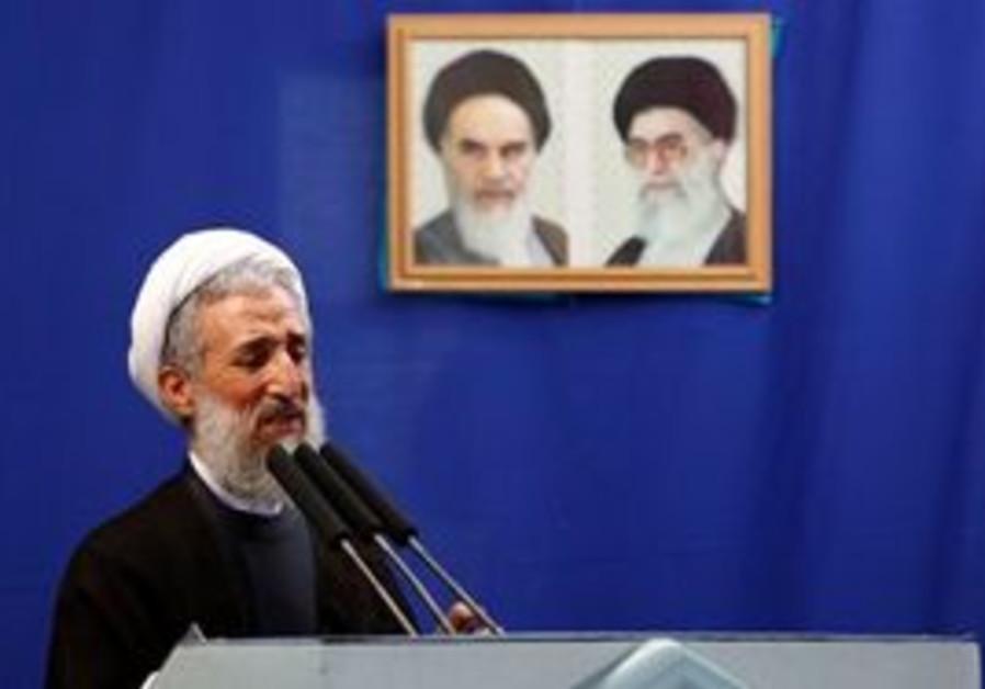 Senior Iranian cleric Hojatoleslam Kazem Sedighi, delivers a Friday prayer sermon, in front of portr
