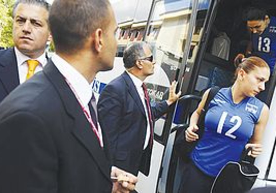 UNDER THE guard of police, the Israeli women's national team volleyball players get off their bus in