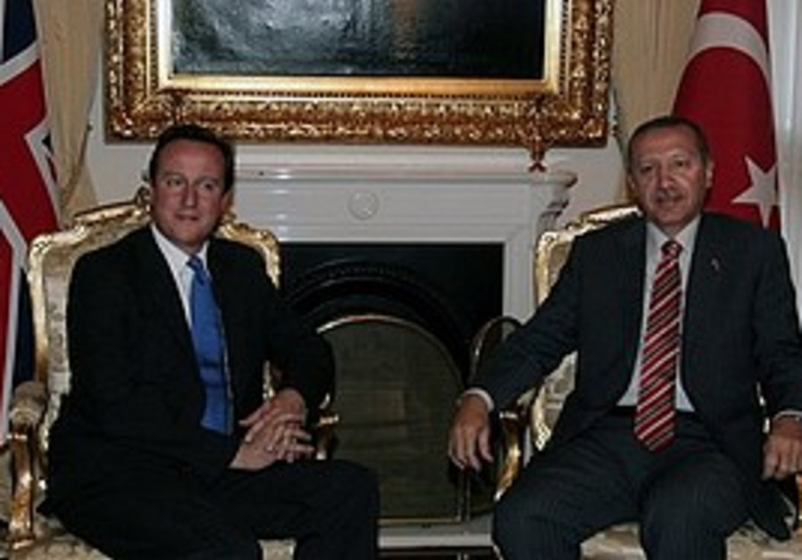 Britain's Prime Minister David Cameron and his Turkish counterpart Recep Tayyip Erdogan pose for cam