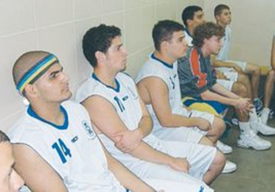 GUY KORACH (in headband) is one of many premier Israeli deaf athletes who are struggling to keep the