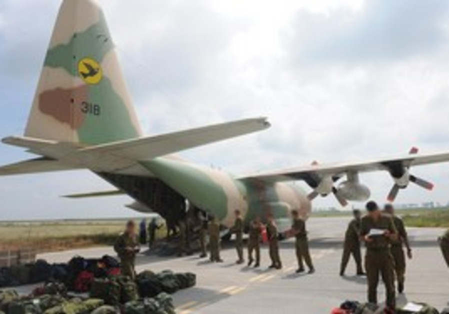 IDF forces unload equipment at a Romanian military base.