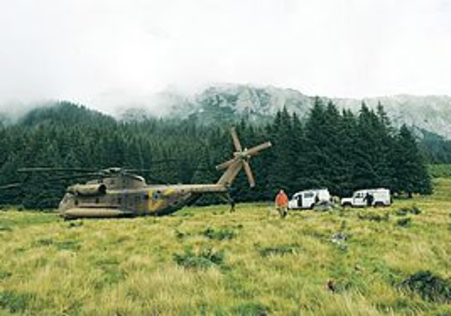 AN IAF helicopter waits near the crash site in Romania yesterday.