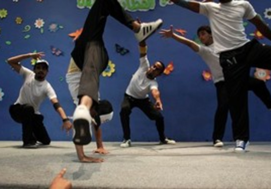 In this photo taken Thursday, July 22, 2010, Palestinian members of the Camps Breakerz breakdancing