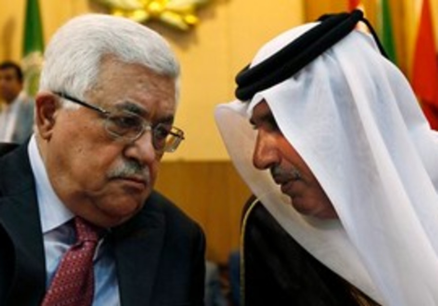 Palestinian President Mahmoud Abbas, left, talks with Qatari Prime Minister Sheikh Hamad bin Jassem