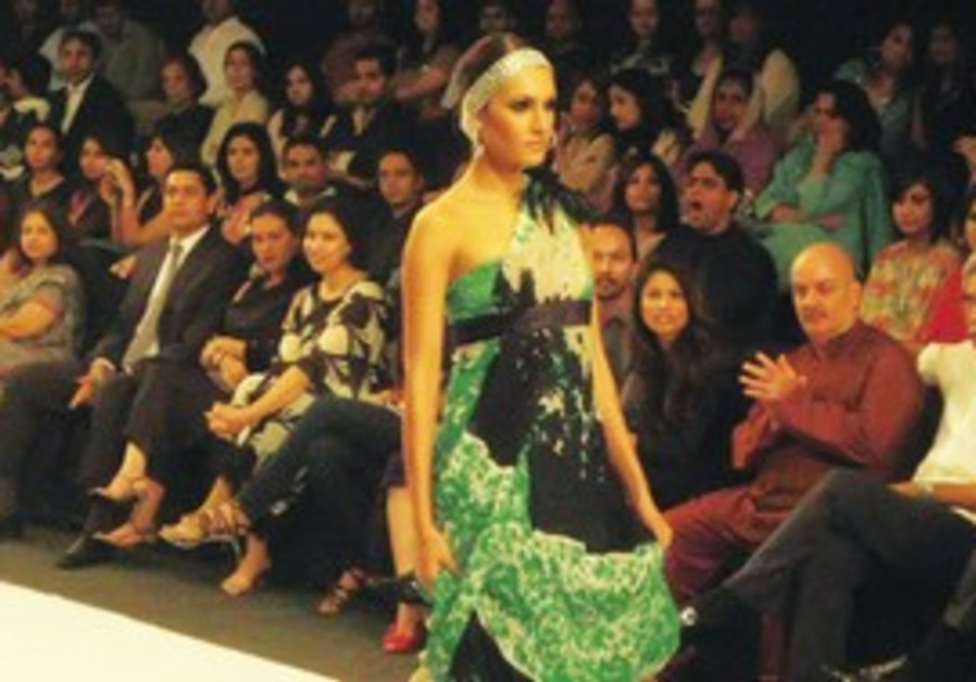 FAIRNESS FOR the fairer sex. A model struts down the catwalk during Pakistan's first-ever fashion we