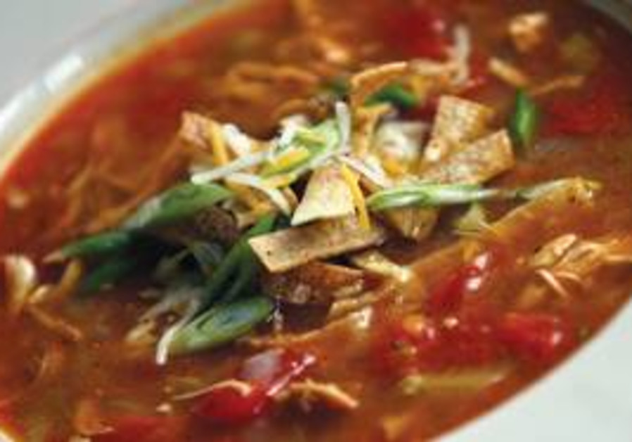 CHICKEN TORTILLA soup. Add corn kernels to the soup's traditional tomato vegetable base and top it w
