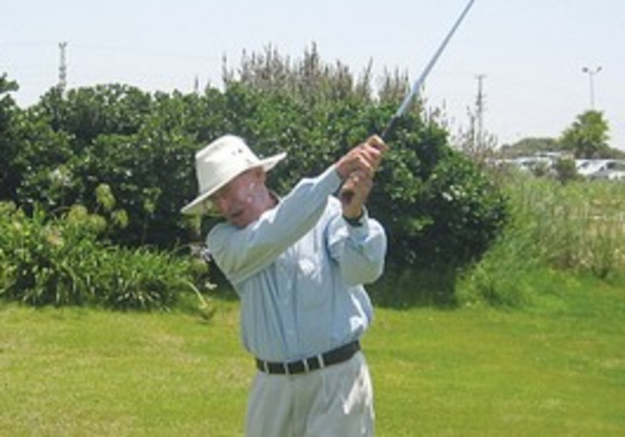 Mati Geri taking a swing at the Ga'ash Golf Club.