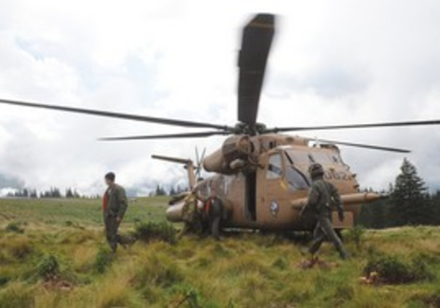 AN IAF helicopter returns from the mountainous area in Romania where an Israeli Sikorsky CH-53 Sea S