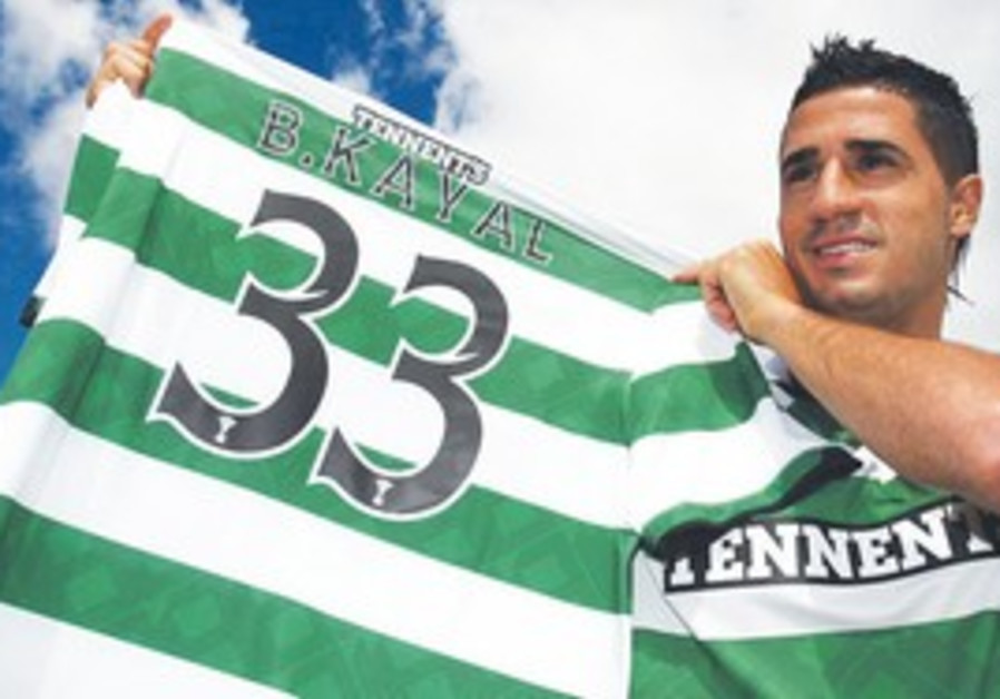 NEWEST CELTIC player Biram Kiyal poses with his new jersey during his official introduction yesterda
