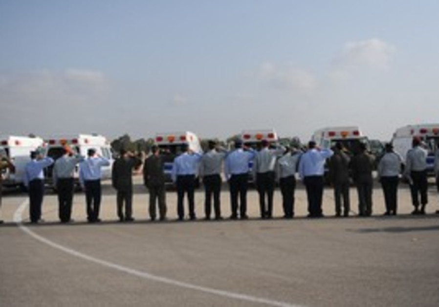 The coffins of the six IAF servicemen killed in Monday's crash arrive in Tel Nof.