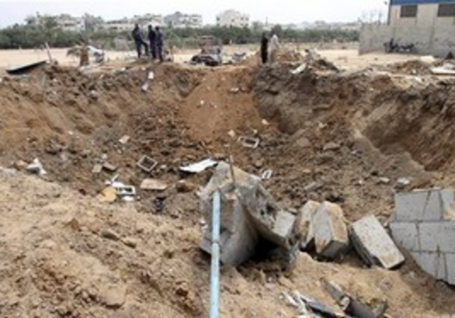 Palestinian security forces from Hamas check the damage in Nuseirat refugee camp in central Gaza Str