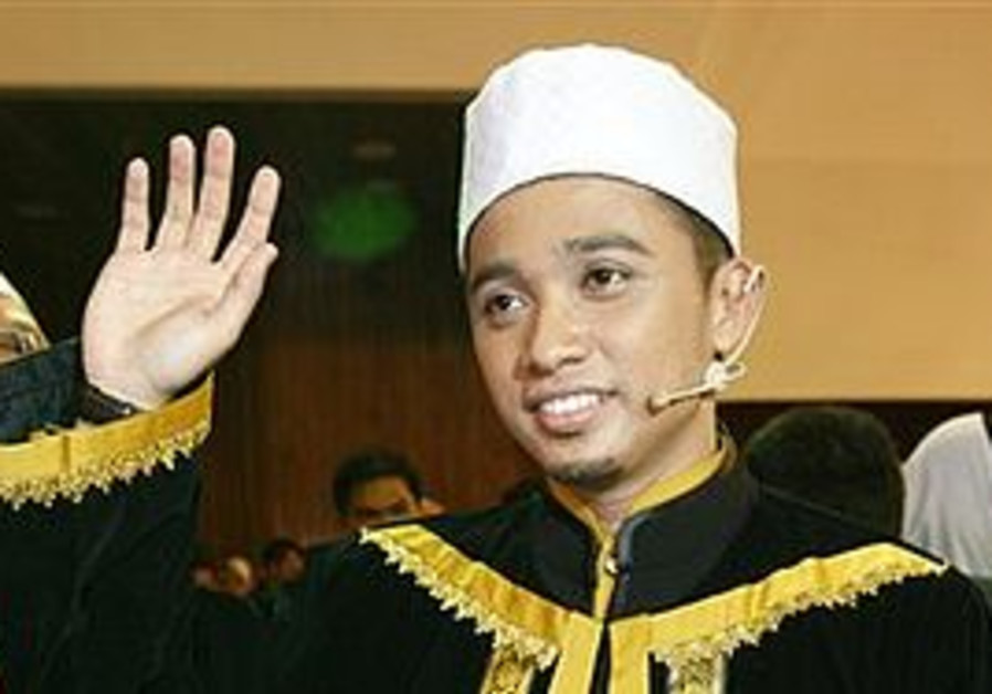 "Muhammad Asyraf Mohd Ridzuan, the winner of the reality TV show ""Imam Muda"" or ""Young Leader"", ackno"