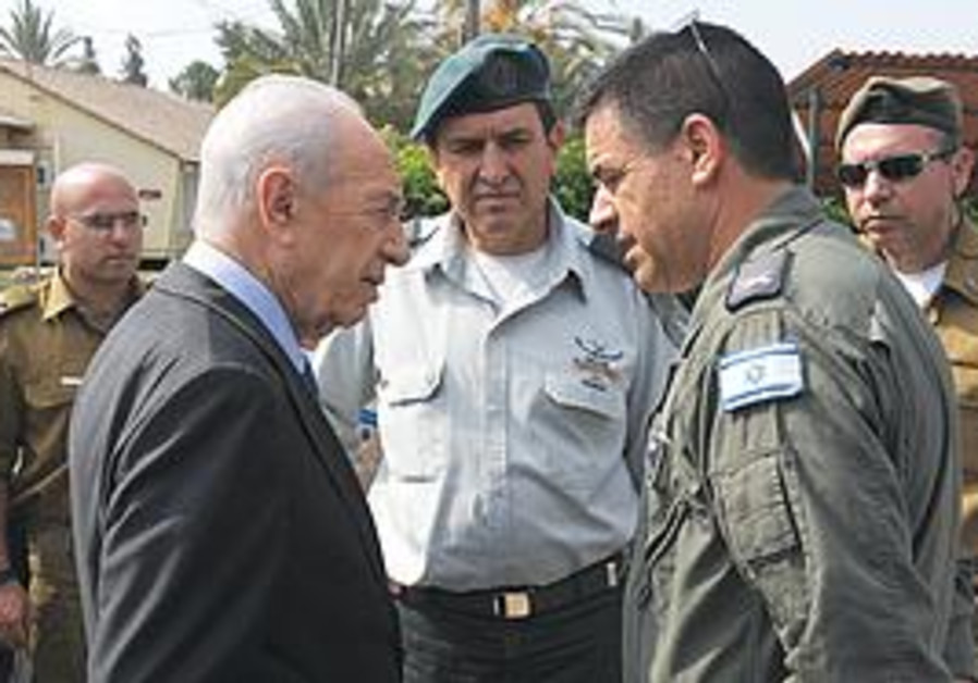 PRESIDENT SHIMON Peres visits the Tel Nof air base yesterday to give his condolences to the families