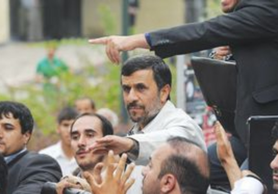 IRANIAN PRESIDENT Mahmoud Ahmadinejad (center) arrives yesterday in Hamedan, 340 km. southwest of T