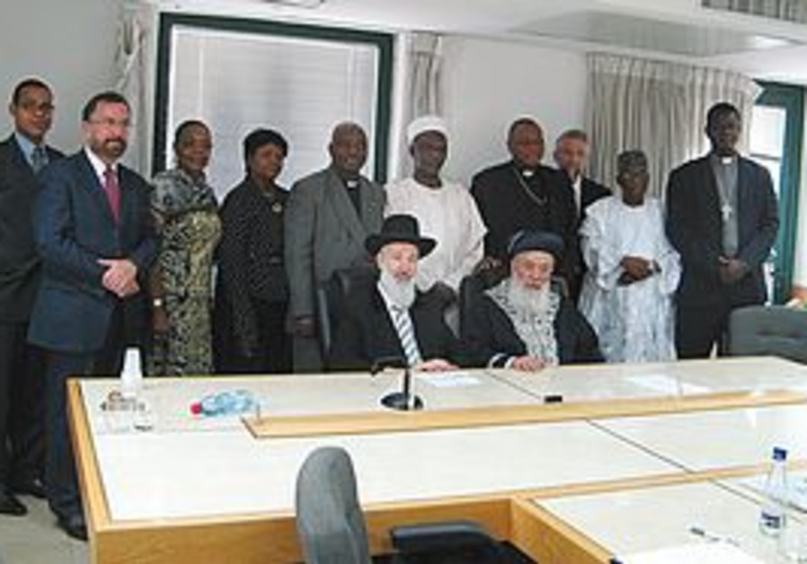 CHIEF RABBIS (seated from left) Yona Metzger and Shlomo Amar, and (standing from left) the Foreign M
