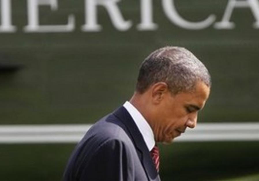 President Barack Obama walks across the South Lawn of the White House in Washington, Monday, Aug. 2,