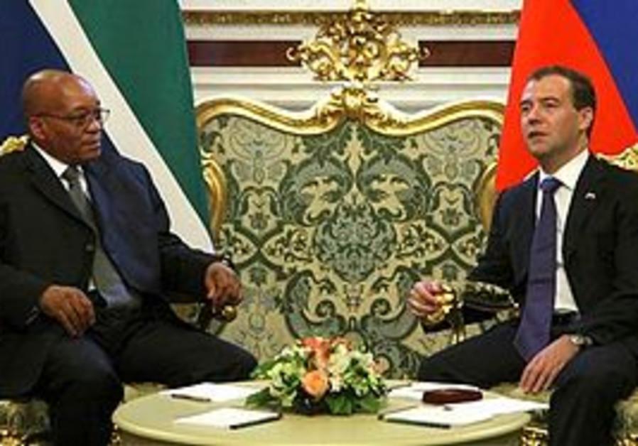 Russian President Dmitry Medvedev, right, speaks with South African President Jacob Zuma in the Krem
