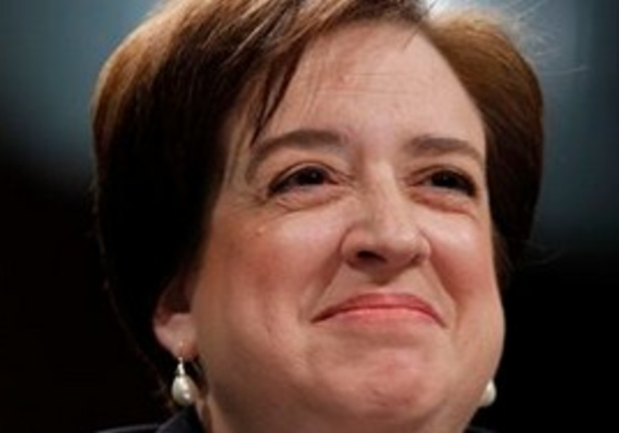 FILE - In this June 30, 2010 file photo, Supreme Court nominee Elena Kagan smiles on Capitol Hill in