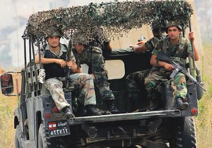 LEBANESE SOLDIERS patrol in Kafr Kila, across the border from Metulla, on Wednesday.