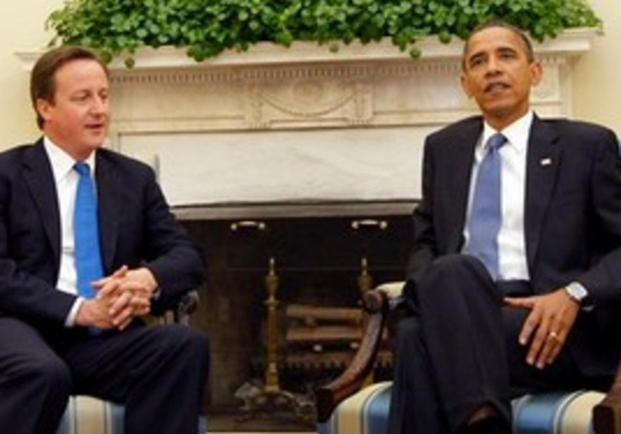 President Barack Obama, right, and British Prime Minister David Cameron, left, talk during their mee