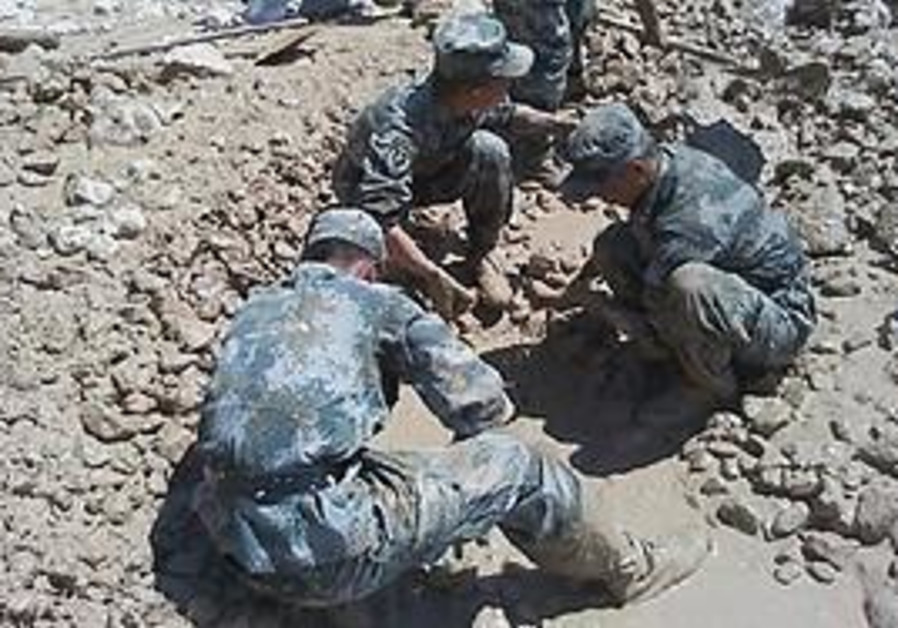 Rescuers search for missing personnel in northwest China