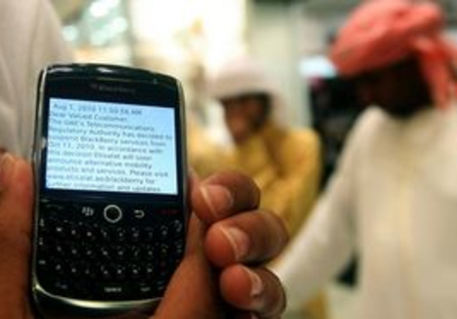 In this photo taken Thursday, Aug. 5, 2010, a BlackBerry user displays a text message sent by his se