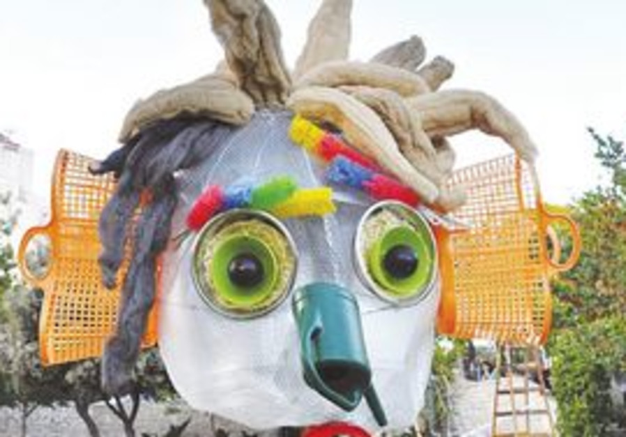 HERE COME THE GIANT PUPPETS: Made of items purchased from various shops in the Mahaneh Yehuda market