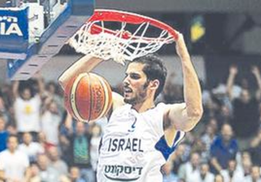 ISRAEL FORWARD Omri Casspi dunks two of his 21 points during the national team's sailed to the easie