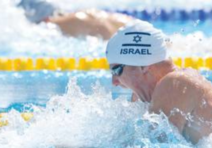 ISRAELI SWIMMER Daniel Malnik participates in a 100-meter breaststroke heat during the Swimming Euro