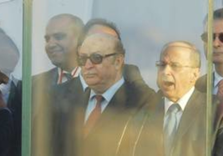 FORMER LEBANESE Brig.-Gen. Fayez Karam (right) listens as Michel Aoun, head of the Christian Free Pa