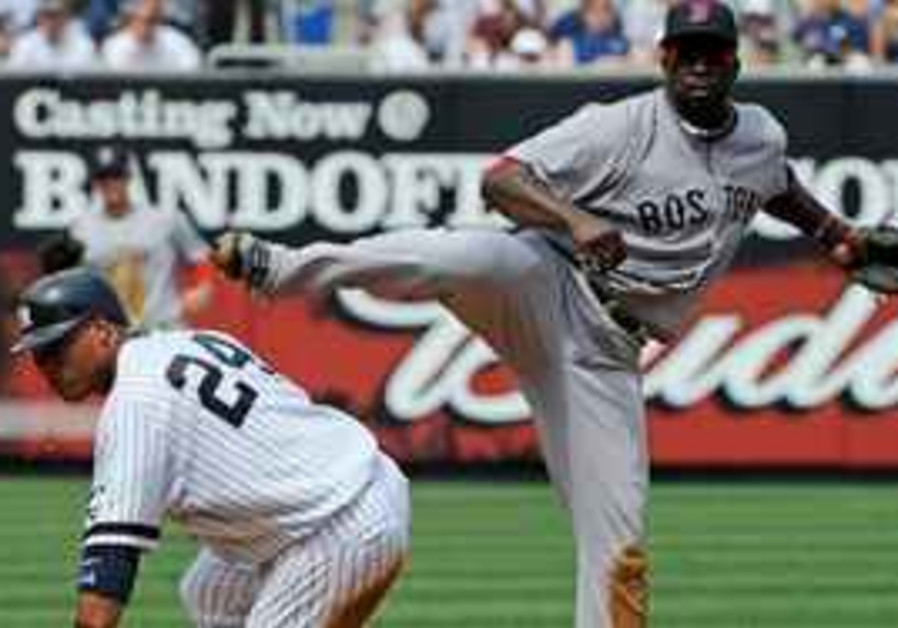 New York Yankees' Robinson Cano, left, is out at second on a fielder's choice as Boston Red Sox seco