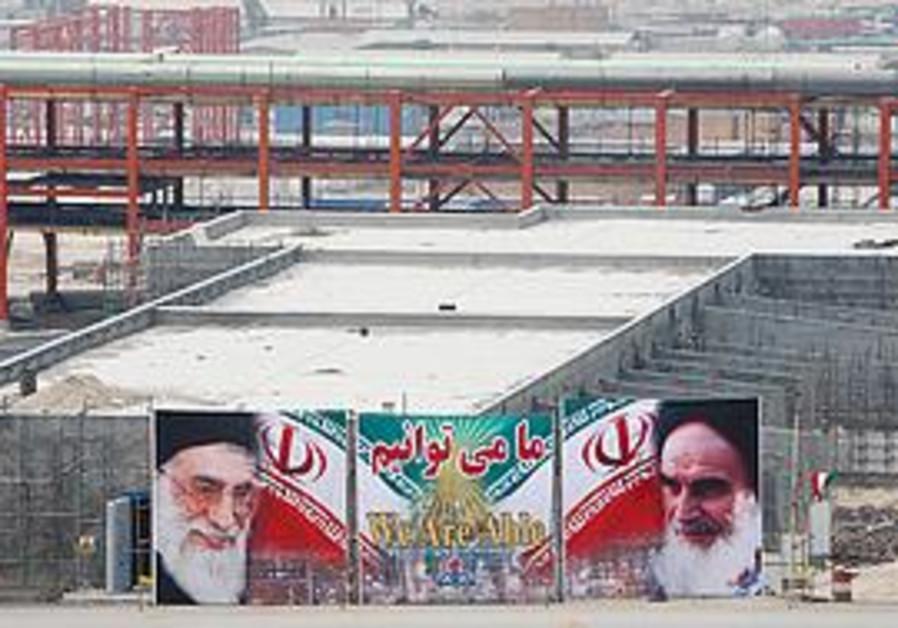 Portraits of Ayatollah Ali Khamenei and Ayatollah Ruhollah Khomeini, adorn a construction site at th