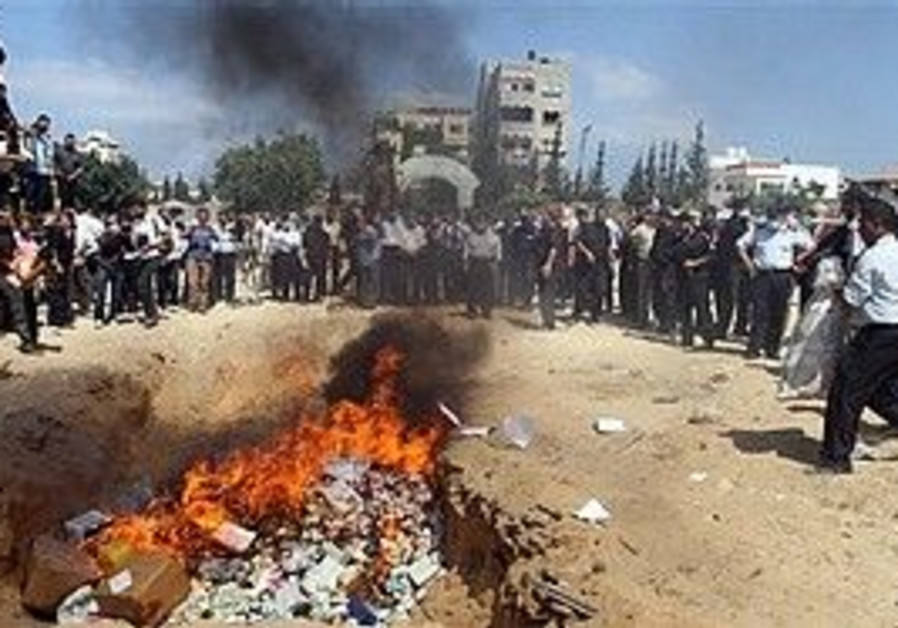 Hamas police burn seized marijuana and illegal drugs at a police compound in Gaza, Tuesday