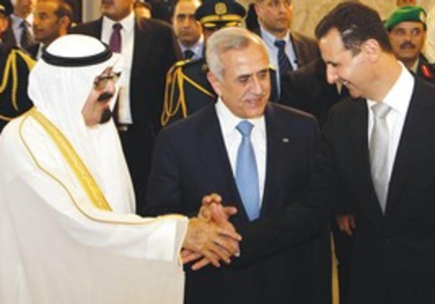 LEBANESE PRESIDENT Michel Suleiman, center, receives Saudi King Abdullah, left, and Syrian President