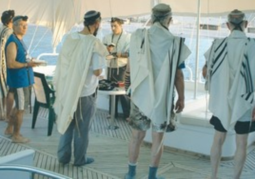 DAVENING IN DAHAB. The day of diving begins with morning minyan off the coast