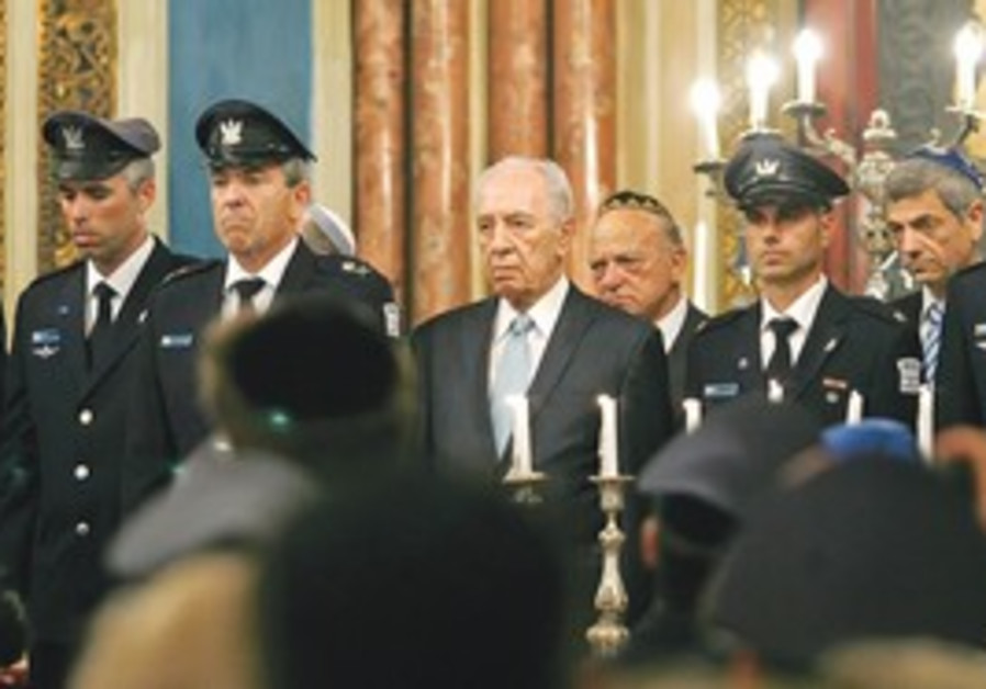 President Shimon Peres attends a memorial service for the six Israeli airmen killed last month held