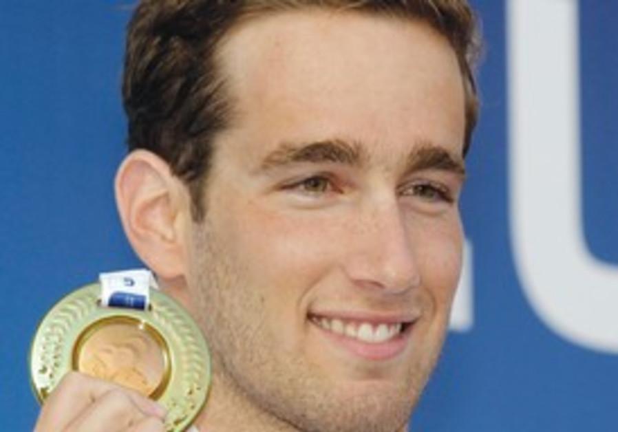 Israeli swimmer Guy Barnea with his bronze medal.