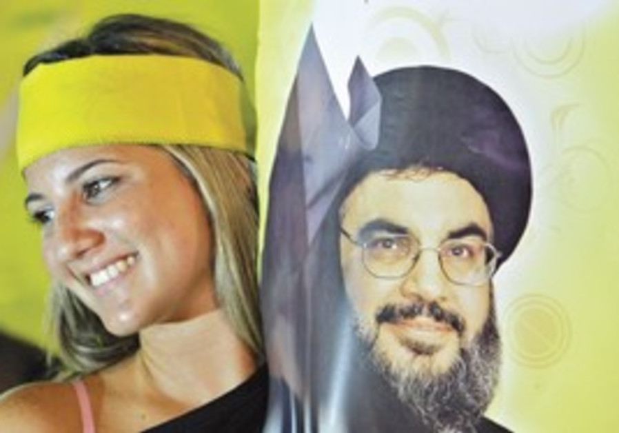 A PRO-HIZBULLAH rally in Beirut last month. 'The group's recent warnings that the Doha agreement is