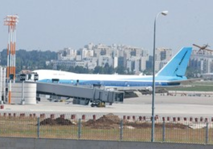 An airplane parked at a gate at Ben Gurion Airport.