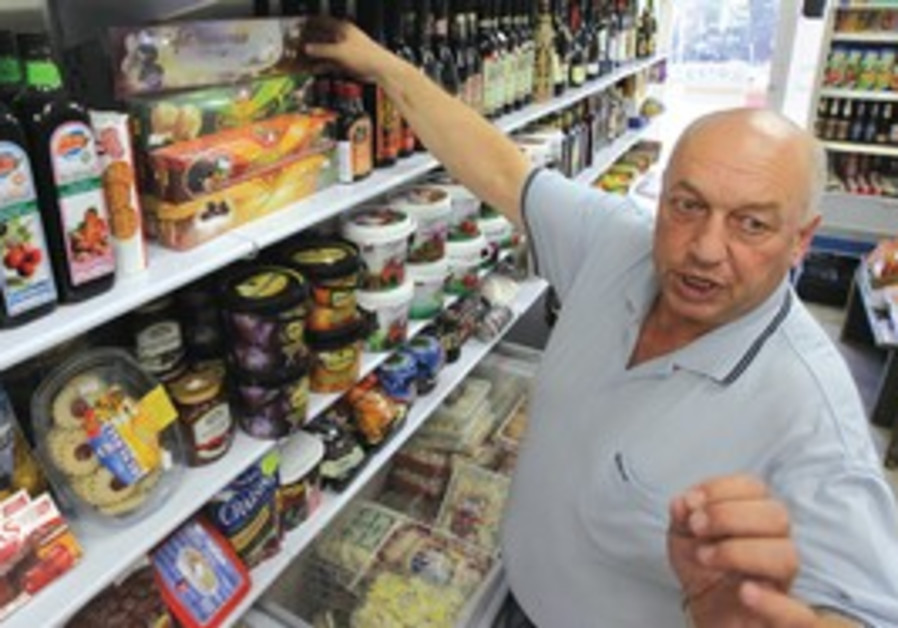 NON-KOSHER HAVEN: Larion Vyborg, owner of a Jerusalem Russian products store