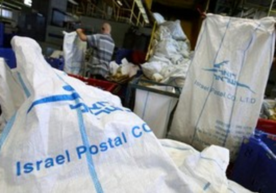 Israeli postal workers processing the mail.