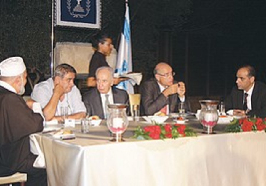 PRESIDENT SHIMON PERES (seated center) hosts Arab local council heads for the Ramadan post-fast ifta