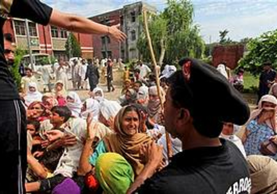 Police, Pakistanis clashed amid flooding.