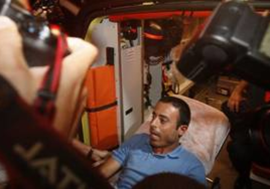 Palestinian Nadim Injaz is taken by ambulance from the Turkish embassy in Tel Aviv, Israel, to be tr