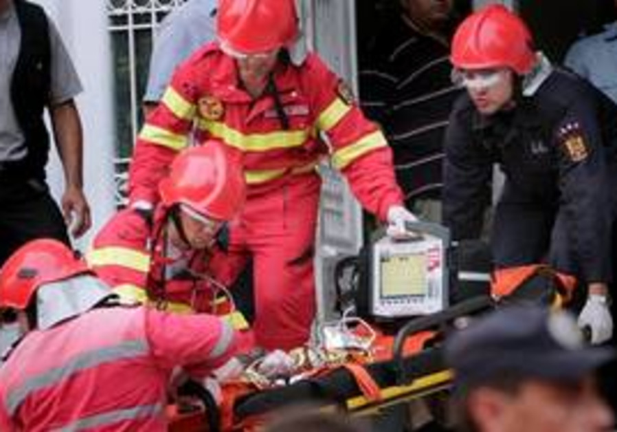 Paramedics evacuate a new born baby following an explosion in the intensive care section of a hospit