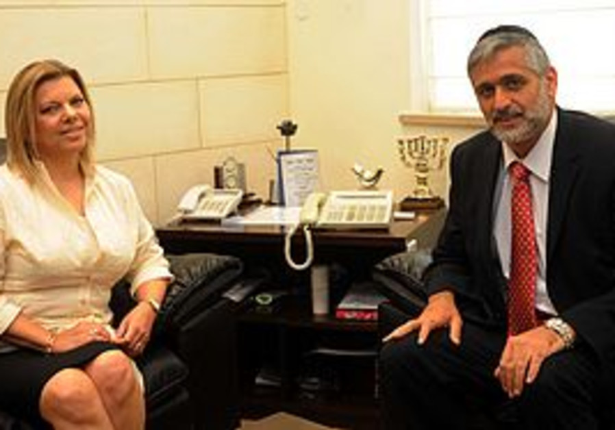 Interior Minister Eli Yishai and prime minister's wife Sarah Netanyahu meet at the interior ministry