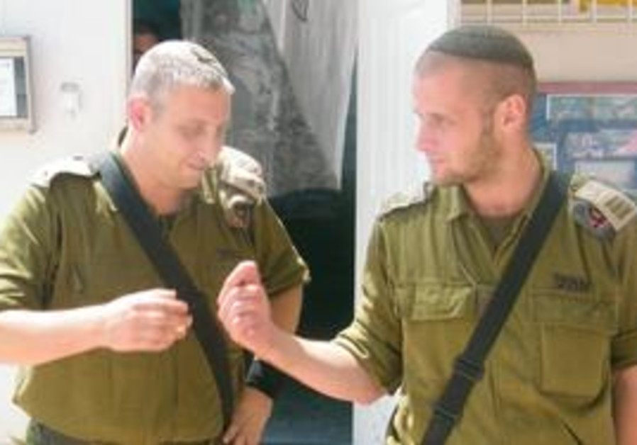 NETZAH YEHUDA Battalion commander Lt.-Col. Dror Spiegel (left) talks to one of his company commander