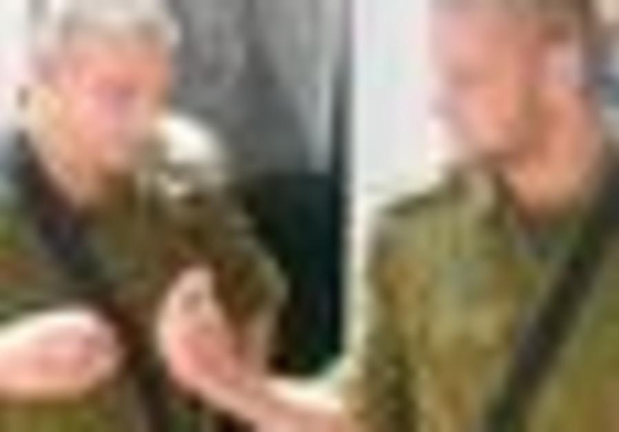 NETZAH YEHUDA Battalion commander Lt.-Col. Dror Spiegel (left) talks to one of his company commander