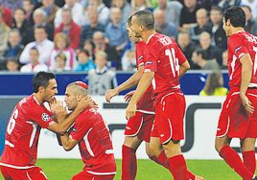 ITAI SHECHTER (second from left) had a kippa hidden in his sock last night, and after scoring Hapoel
