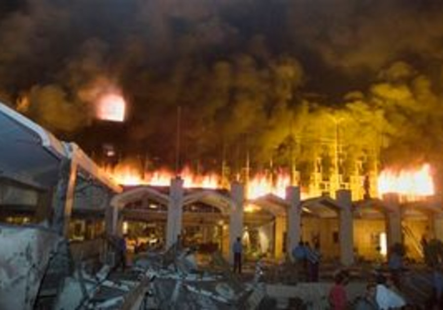 In this Saturday, Sept 20, 2008 picture, the Marriott hotel in Islamabad, Pakistan is engulfed in f